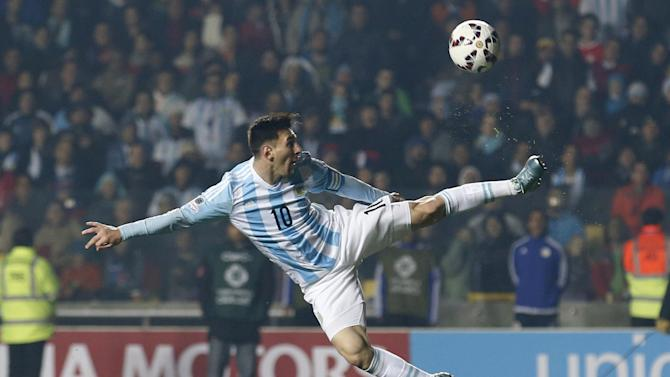 Argentina's Lionel Messi  kicks the ball during a Copa America semifinal soccer match against Paraguay at the Ester Roa Rebolledo Stadium in Concepcion, Chile, Tuesday, June 30, 2015. (AP Photo/Silvia Izquierdo)