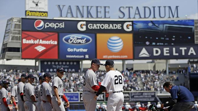 New York Yankees manager Joe Girardi (28) greets Boston Red Sox manager John Farrell (53) at an opening day baseball game at Yankee Stadium in New York, Monday, April 1, 2013.  (AP Photo/Kathy Willens)