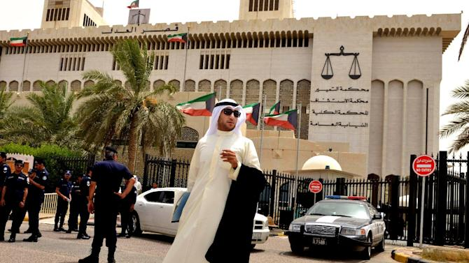 A Kuwaiti lawyer stands outside the constitutional court in Kuwait City, Sunday, June 16, 2013. Kuwait's constitutional court forced new parliamentary elections Sunday, dissolving the current chamber on the basis of flaws in the election law, the media reported. The decision may set the state for a new wave of political showdowns in the Gulf nation. (AP Photo/Gustavo Ferrari)