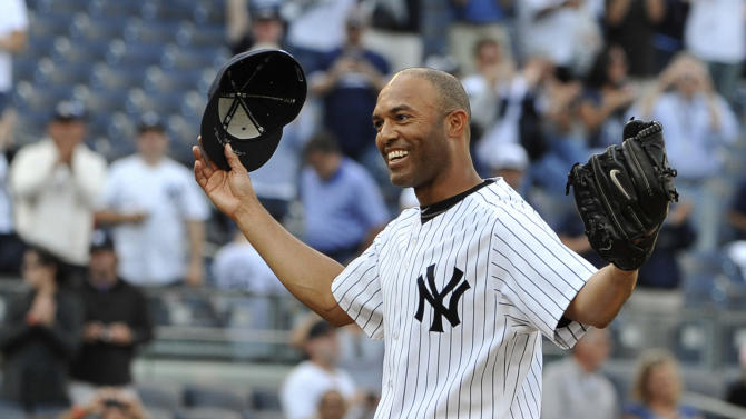FILE - In this Sept, 19, 2011 file photo, New York Yankees closer Mariano Rivera acknowledges the cheers of the crowd after recording his 602nd career save, after the Yankees beat the Minnesota Twins 6-4 in a baseball game at Yankee Stadium in New York. At a news conference Saturday, March 9, 2013, Rivera said he will retire after this season. (AP Photo/Kathy Kmonicek, File)