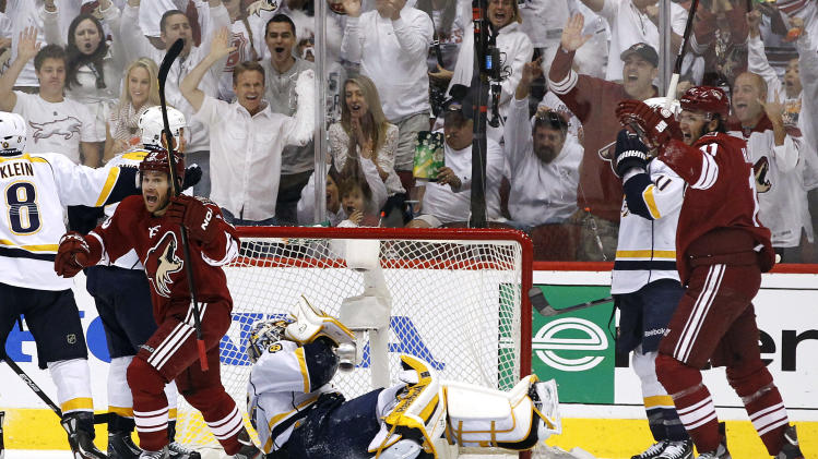 Phoenix Coyotes' Ray Whitney, left, and Martin Hanzal, right, of the Czech Republic, turn to celebrate a goal by Radim Vrbata, as Nashville Predators goalie Pekka Rinne, of Finland, sits on the ice after giving up the goal in the second period during Game 2 in an NHL hockey Stanley Cup Western Conference semifinal playoff series, Sunday, April 29, 2012, in Glendale, Ariz. (AP Photo/Ross D. Franklin)