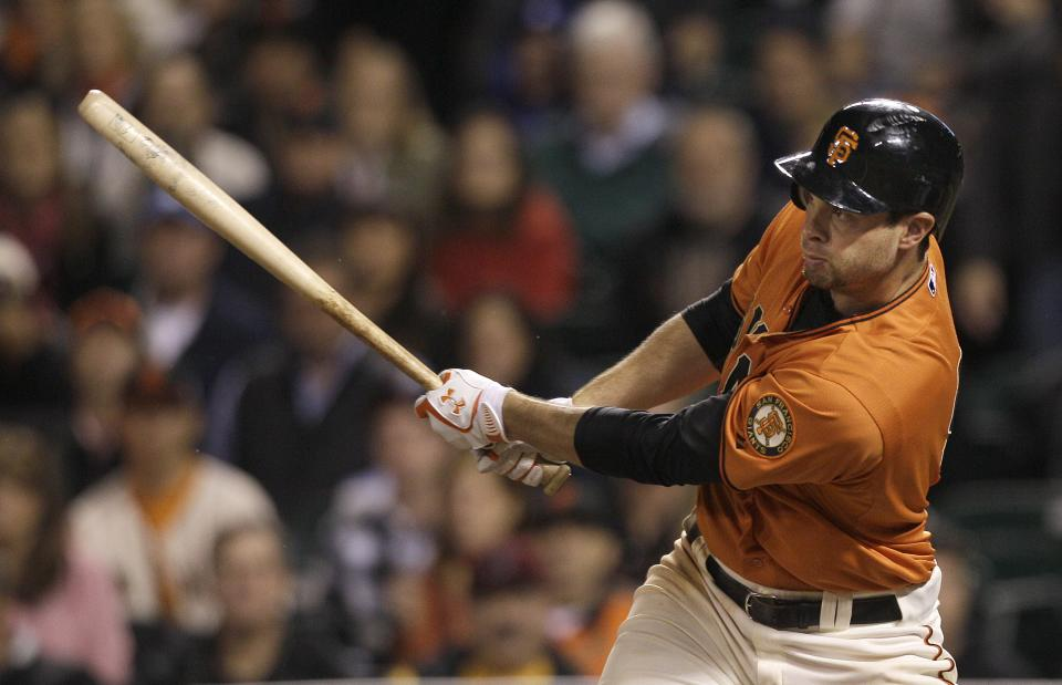 San Francisco Giants' Brandon Belt hits a two-run single against the Los Angeles Dodgers during the eighth inning of a baseball game in San Francisco, Friday, July 27, 2012. (AP Photo/Jeff Chiu)