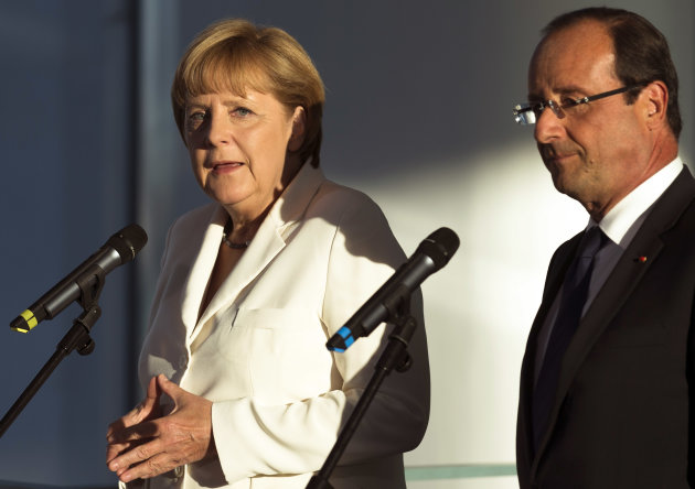 Germany&#39;s Chancellor Angela Merkel, left, and Frances President Francois Hollande brief the media prior to a meeting at the chancellery in Berlin, Thursday, Aug. 23, 2012 .The leaders of Germany and France are stressing that it&#39;s up to Greece to keep pursuing painful reforms as it strives to keep its place in the euro. Chancellor Angela Merkel and President Francois Hollande were meeting Thursday before both hold talks over the next two days with Greece&#39;s new prime minister, Antonis Samaras. (AP Photo/Markus Schreiber)