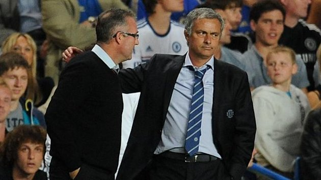 Chelsea's Manager Jose Mourinho (right) puts his arm around Aston Villa's Manager Paul Lambert (PA Photos)