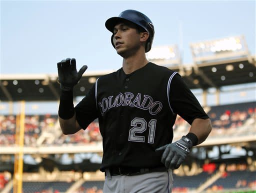 Colvin's 2 HRs lead Rockies over Strasburg, Nats