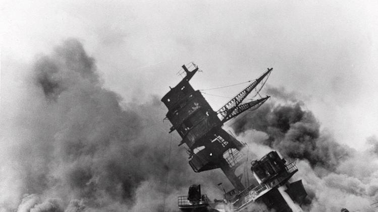 FILE - In this Dec. 7, 1941 file photo, smoke rises from the battleship USS Arizona as it sinks during a Japanese surprise attack on Pearl Harbor, Hawaii. (AP File Photo)