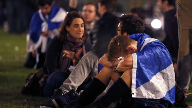"""Supporters from the """"Yes"""" Campaign react as they sit in George Square in Glasgow, Scotland"""