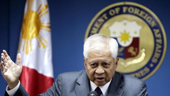 "Philippine Foreign Affairs Secretary Albert Del Rosario gestures during a news conference Wednesday June 19, 2013 in Manila, Philippines where he talked about three big issues involving the Philippines that included the presence of the Philippine contingent to the UN peacekeeping forces at the Golan Heights. Del Rosario said the Philippines still is committed to keep the Philippine peacekeepers until August 3, 2013 and subject to ""conditionalities"" beyond the period. (AP Photo/Bullit Marquez)"