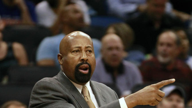 New York Knicks head coach Mike Woodson directs his team against the Orlando Magic during the first half of an NBA basketball game, Tuesday, Nov. 13, 2012, in Orlando, Fla. (AP Photo/John Raoux)