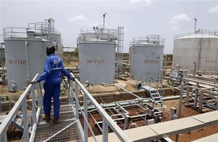 A worker walks at the power plant of an oil processing facility at an oilfield in Unity State April 22, 2012. REUTERS/Goran Tomasevic