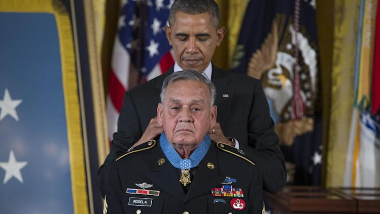 Sgt. First Class Jose Rodela is awarded the Medal of Honor by President Barack Obama during a ceremony in the East Room of the White House in Washington, Tuesday, March 18, 2014. President Obama awarded 24 Army veterans the Medal of Honor for conspicuous gallantry in recognition of their valor during major combat operations in World War II, the Korean War and the Vietnam War. (AP Photo/ Evan Vucci)