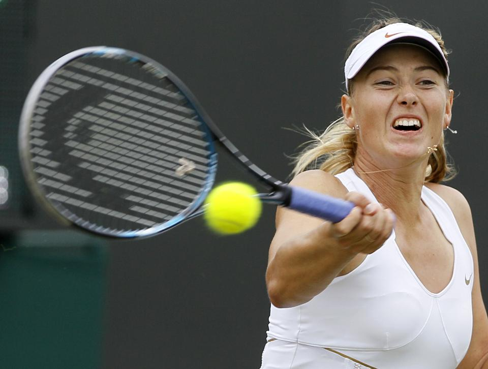Russia's Maria Sharapova returns a shot to Klara Zakopalova of the Czech Republic during their match at the All England Lawn Tennis Championships at Wimbledon, Saturday, June 25, 2011.(AP Photo/Kirsty Wigglesworth)