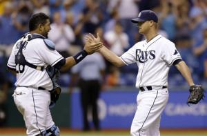 Cobb pitches 4-hitter, surging Rays beat A's 5-0