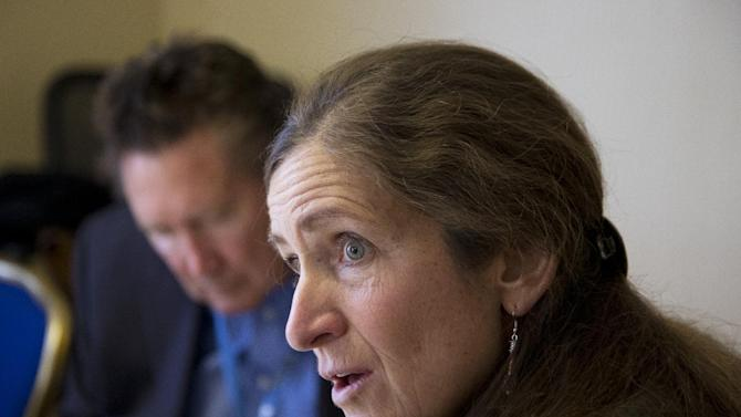 Dr. Argye Elizabeth Hillis of John Hopkins Hospital, with her patient Robert Voogt, left, speaks to The Associated Press during an interview in Washington, Sunday, Feb. 14, 2016. Voogt suffers from primary progressive aphasia, a brain disorder. Families may not even seek care because they assume a loved one's increasingly garbled attempts to communicate are because of age-related dementia, said Hillis. (AP Photo/Manuel Balce Ceneta)