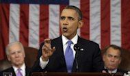 "FILE - In this Feb. 12, 2013, file photo, President Barack Obama, flanked by Vice President Joe Biden and House Speaker John Boehner of Ohio, gestures as he gives his State of the Union address during a joint session of Congress on Capitol Hill in Washington. Obama is talking about climate change like it was 2009. The president, who barely uttered the words ""climate change"" or ""global warming"" during the second half of his first term and during the re-election campaign, has re-inserted it boldly back into his lexicon. (AP Photo/Charles Dharapak, Pool, File)"