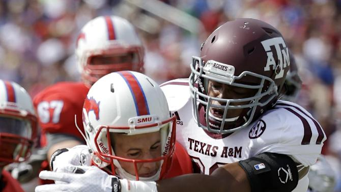 SMU quarterback Kolney Cassel (17) is sacked by Texas A&M linebacker Shaan Washington (33) in the first half of an NCAA college football game, Saturday, Sept. 20, 2014, in Dallas. (AP Photo/Tony Gutierrez)