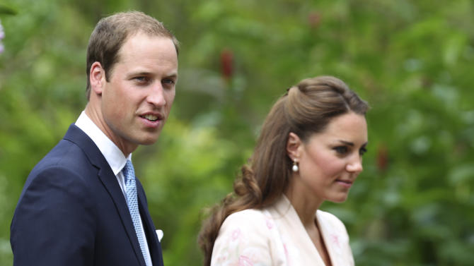 Prince William and his wife Kate, Duke and Duchess of Cambridge, tour the Orchid Garden within the Singapore Botanical Gardens in Singapore on Tuesday, Sept. 11, 2012. The British royal couple is on an official three-day trip to Singapore. (AP Photo/Stephen Morrison, Pool)