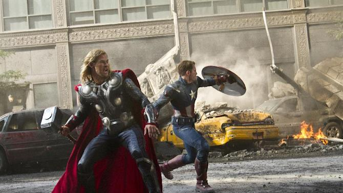 "FILE - In this undated file image released by Disney, Chris Hemsworth portrays Thor, left, and  and Chris Evans portrays Captain America in a scene from ""The Avengers."" ""The Avengers"" are teaming up for a motion-control video game. Ubisoft on May 9, 2012 announced a partnership with Marvel to create a game based on the superhero alliance for Nintendo's upcoming Wii U console and Microsoft's Kinect system for the Xbox 360. (AP Photo/Disney, Zade Rosenthal, File)"