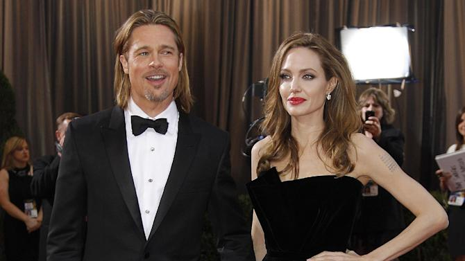 "FILE - This Feb. 26, 2012 file photo shows actress Angelina Jolie, right, and actor Brad Pitt at the 84th Academy Awards in the Hollywood section of Los Angeles. Jolie says that she has had a preventive double mastectomy after learning she carried a gene that made it extremely likely she would get breast cancer. The Oscar-winning actress and partner to Brad Pitt made the announcement in  an op-ed she authored for Tuesday's New York Times under the headline, ""My Medical Choice."" She writes that between early February and late April she completed three months of surgical procedures to remove both breasts. (AP Photo/Amy Sancetta, file)"