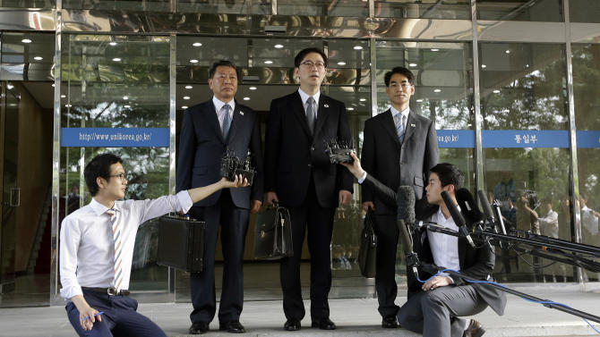 Chun Hae-sung, center, the head of South Korea's working-level delegation, speaks to the media while standing with delegates Kwon Young-yang, left, and Kang Jong-won before leaving for Panmunjom at the Office of the South Korea-North Korea Dialogue in Seoul, South Korea, Sunday, June 9, 2013. North and South Korea will meet in the village straddling their heavily armed border Sunday for the first government-level talks on the peninsula in more than two years as they try to lower tension and restore stalled projects that once symbolized their rapprochement. (AP Photo/Lee Jin-man)