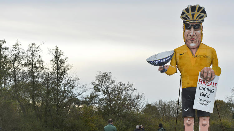 Residents view an effigy of U.S. cyclist Lance Armstrong ahead of Bonfire Night celebrations in Edenbridge, south east England
