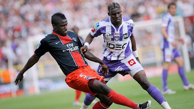 Then Paris Saint-Germain defender Bernard Mendy (L) tackles Toulouse forward Fode Mansare during a French L1 match in Toulouse on May 3, 2008