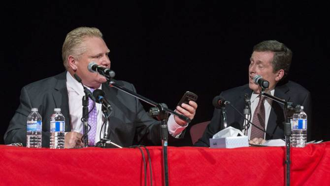 Toronto mayoral candidate Doug Ford and candidate John Tory participate in a municipal debate for the upcoming election in Toronto