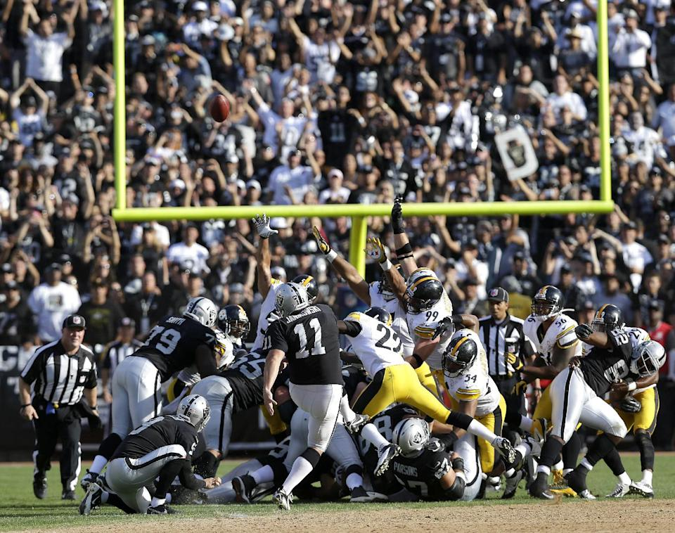 Oakland Raiders kicker Sebastian Janikowski kicks a game-winning 43-yard field goal during the fourth quarter of an NFL football game against the Pittsburgh Steelers in Oakland, Calif., Sunday, Sept. 23, 2012. Oakland won the game 34-31. (AP Photo/Marcio Jose Sanchez)