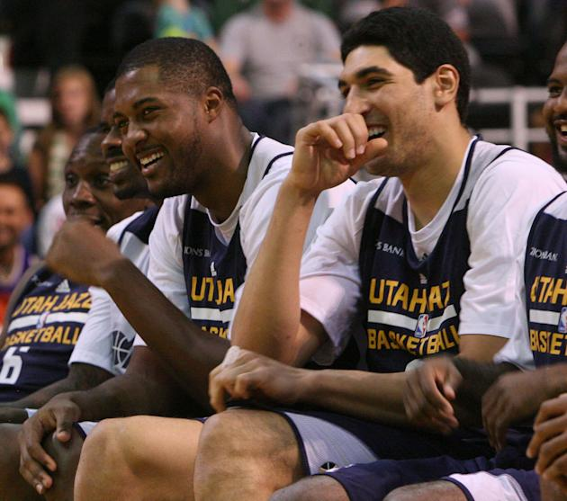 Utah Jazz forward Derrick Favors and center Enes Kanter laugh at the dance moves of Trey Burke. Utah Jazz fans filled  EnergySolutions Arena to get a glimpse at this year's players during the annual s