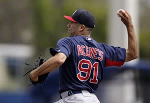 Boston Red Sox relief pitcher Alfredo Aceves delivers during the first inning of the Red Sox 1-0 loss to the Toronto Blue Jays in a spring training baseball game in Dunedin, Fla., Friday, March 22, 2013. (AP Photo/Kathy Willens)