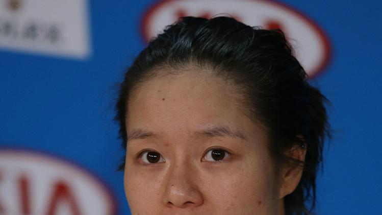 China's Li Na answers a question during press conference following her loss to Victoria Azarenka of Belarus in women's final at the Australian Open tennis championship in Melbourne, Australia, Saturday, Jan. 26, 2013. (AP Photo/Aaron Favila)