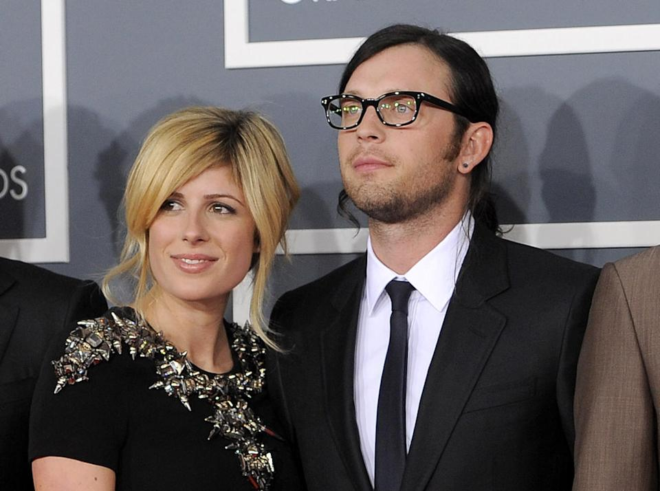 FILE - This Feb. 12, 2012 file photo shows Jessie Baylin with her husband  Nathan Followill from The band Kings of Leon at the 54th annual Grammy Awards in Los Angeles. Kings of Leon spokesman Ken Weinstein says the couple are expecting their first child in December.  (AP Photo/Chris Pizzello, file)