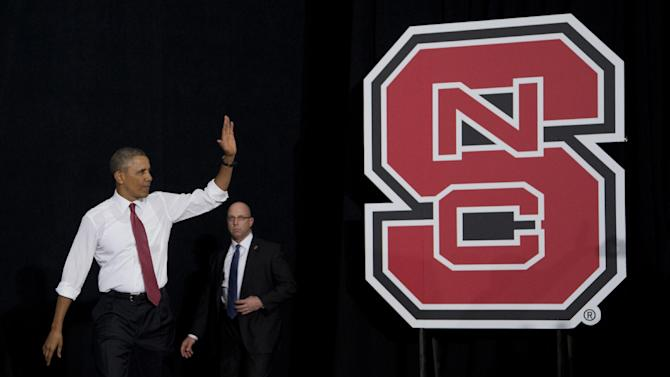 President Barack Obama waves as he arrives to talk about the economy, jobs and manufacturing, Wednesday, Jan. 15, 2014, at North Carolina State University in Raleigh, N.C. (AP Photo/Carolyn Kaster