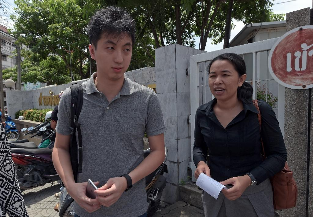 Hong Kong photographer to face Thai trial over flak jacket