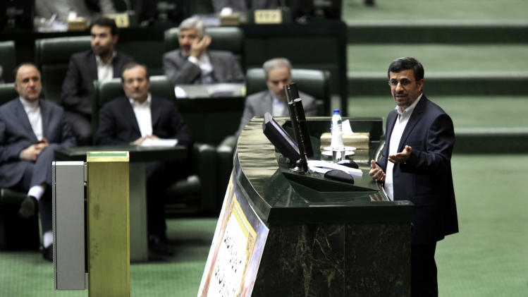 Iranian President Mahmoud Ahmadinejad speeches at the parliament in Tehran, Iran, Wednesday, Jan. 16, 2013. Ahmadinejad admitted Wednesday that sanctions have slowed down Iran's growth and disrupted its foreign trade and said the country has to stop relying on oil revenues in state budget to overcome sanctions. (AP Photo/Vahid Salemi)