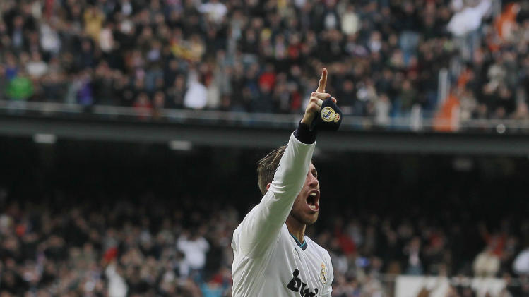 Real Madrid's Sergio Ramos celebrates his goal during a Spanish La Liga soccer match against FC Barcelona at the Santiago Bernabeu stadium in Madrid, Spain, Saturday, March 2, 2013. (AP Photo/Andres Kudacki)