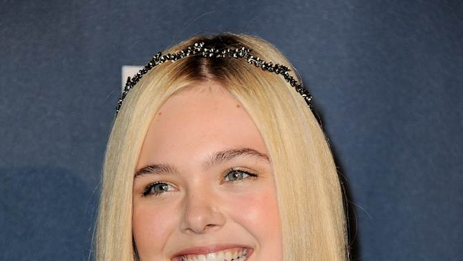 Elle Fanning arrives at the 24th Annual GLAAD Media Awards at the JW Marriott on Saturday, April 20, 2013 in Los Angeles. (Photo by Jordan Strauss/Invision/AP)