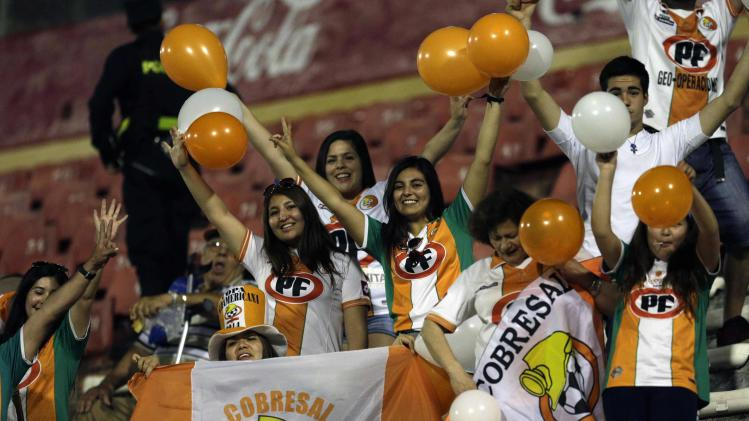 Fans of Chile's Cobresal react before their team play against Paraguay's General Diaz in their Copa Sudamericana soccer match in Luque