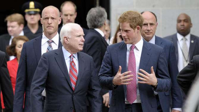 Prince Harry talks with Sen. John McCain, R-Ariz., as they walk out of the Russell Senate Office Building on Capitol Hill, Washington, Thursday, May 9, 2013, after viewing an exhibition staged by the HALO Trust. (AP Photo/Susan Walsh)