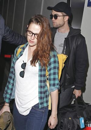 Robert Pattinson and Kristen Stewart are seen at LAX Airport in Los Angeles on November 26, 2012 -- Getty Premium
