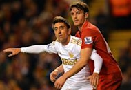 Liverpool's English defender Jack Robinson (R) vies with Swansea City's Spanish midfielder Pablo Hernandez (L) during the English League Cup Fourth Round football match between Liverpool and Swansea City at Anfield in Liverpool. Swansea won the game 3-1