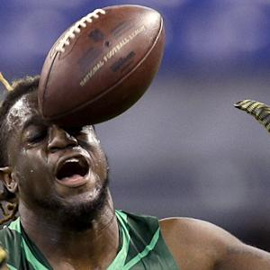 That's why they play defense!: Defensive prospects drop passes during 2015 NFL Scouting Combine drills