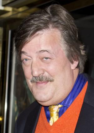 FILE - Actor Stephen Fry at a central London cinema, London, in this Thursday, Dec. 8, 2011 file photo. The entertainment industry is using its star power and money power to raise a storm of protest over the anti-gay legislation in Russia that is battering the image of the Winter Olympics in Sochi. Actor-playright Harvey Fierstein, British writer-actor Stephen Fry and `Star Trek actor George Takei are among those who have publicly blasted the new law, fueling an uproar that is overshadowing the games with the opening ceremony less than six months away.(AP Photo/Joel Ryan, File)