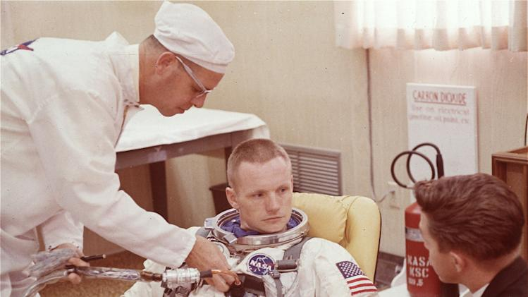"FILE - In this March 9, 1966 file photo, Astronaut Neil Armstrong is seated during a suiting up exercise Cape Kennedy, Florida, in preparation for the Gemini 8 flight.  The family of Neil Armstrong, the first man to walk on the moon, says he has died at age 82. A statement from the family says he died following complications resulting from cardiovascular procedures. It doesn't say where he died. Armstrong commanded the Apollo 11 spacecraft that landed on the moon July 20, 1969. He radioed back to Earth the historic news of ""one giant leap for mankind."" Armstrong and fellow astronaut Edwin ""Buzz"" Aldrin spent nearly three hours walking on the moon, collecting samples, conducting experiments and taking photographs. In all, 12 Americans walked on the moon from 1969 to 1972.  (AP Photo/FILE)"