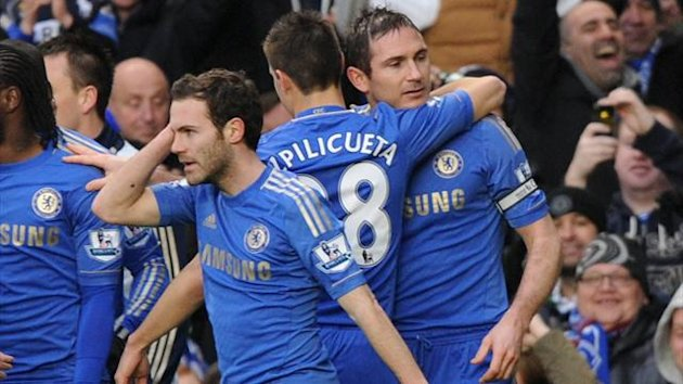 West Ham fans aim objects at Frank Lampard and his Chelsea team-mates as they celebrate his 200th goal