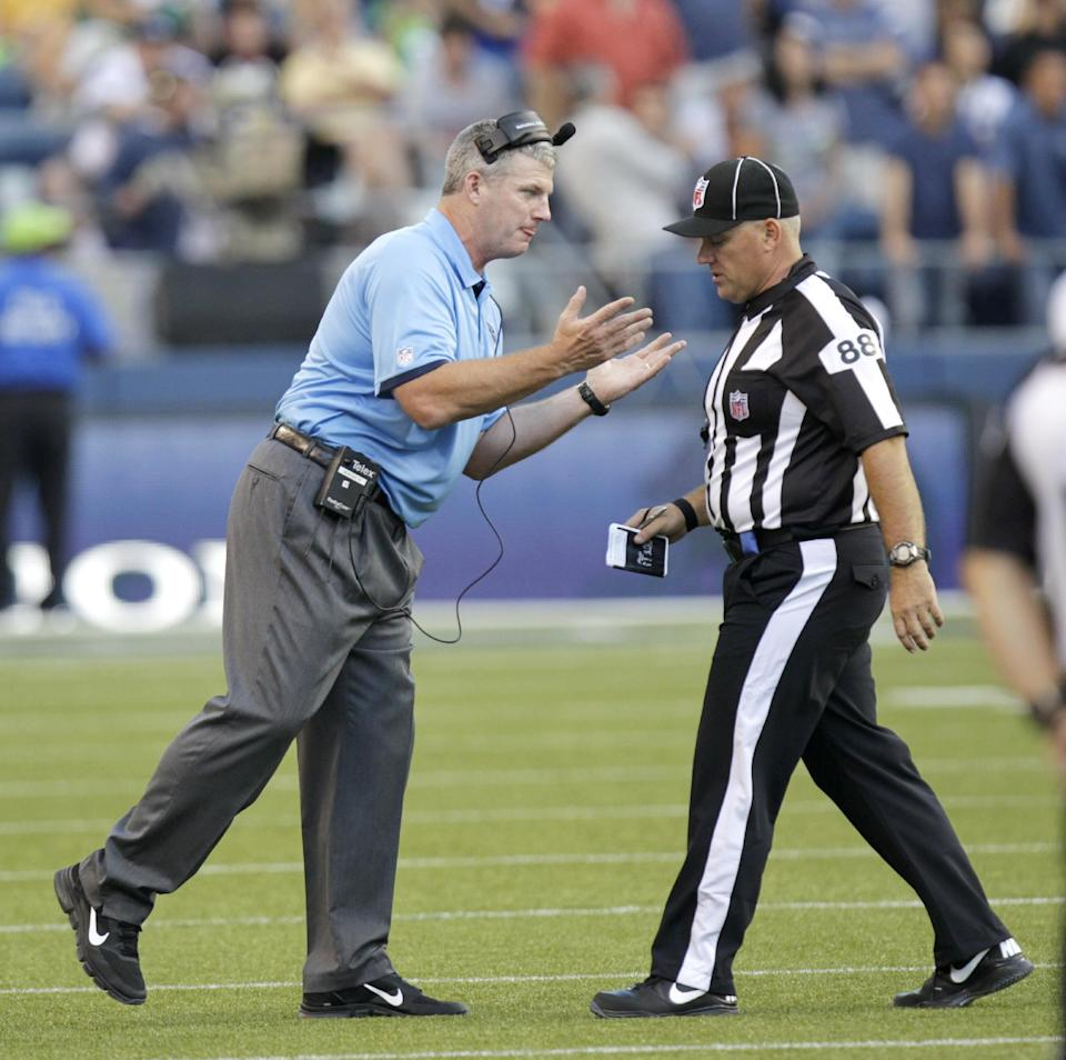 Tennessee Titans head coach Mike Munchak, left, argues a play with a replacement official in the first half of an NFL football preseason game against the Seattle Seahawks, Saturday, Aug. 11, 2012, in Seattle. (AP Photo/Rick Bowmer)