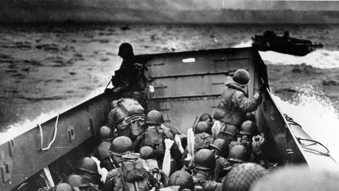 FILE - In this photo provided by the U.S. Coast Guard, a U.S. Coast Guard landing barge, tightly packed with helmeted soldiers, approaches the shore at Normandy, France, during initial Allied landing operations, on June 6, 1944.(AP Photo, File)