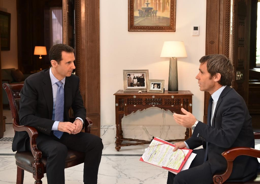 Assad says no Iran troops in Syria, denies fresh chemical attacks