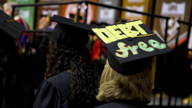 """This 2014 photo provided by The University of Texas at Dallas shows, a cap worn by Laurel Mohrman at her graduation from the University of Texas at Dallas. She decorated the mortarboard with the words, """"DEBT free,"""" to celebrate her lack of college debt. Any commencement is likely to include some students who've decorated their mortarboards with everything from thank-yous to inspirational messages. (Kevin Yang/The University of Texas at Dallas via AP)"""