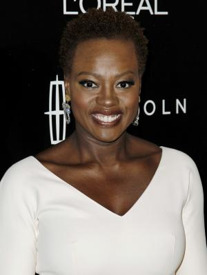 """FILE - In this Feb. 23, 2012 file photo, actress Viola Davis arrives at the 5th annual Essence Black Women in Hollywood Luncheon in Beverly Hills, Calif. Davis urged graduating seniors at the high school in the struggling Rhode Island city where she grew up to treasure """"hard times and joyous moments."""" Davis spoke to Central Falls High School seniors, members of student government and student actors Thursday, Mat 24, 2012. She is a 1983 graduate of the school and has continued to support education in Central Falls. (AP Photo/Matt Sayles, file)"""